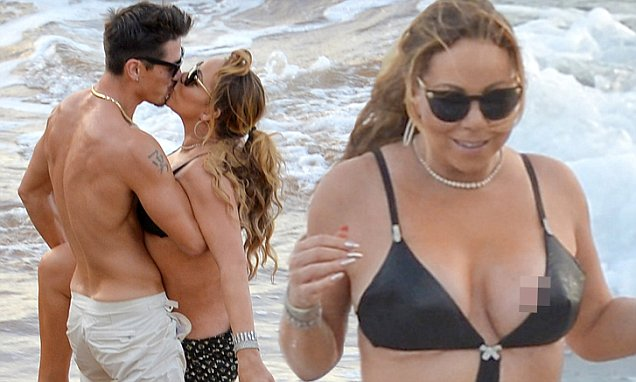 *PREMIUM EXCLUSIVE* Mariah Carey and Bryan Tanaka Pack On The PDA Causing A Nip Slip In Hawaii n